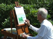 easel with unfinished work