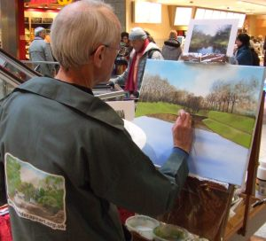 Pat Harrison en plein air at a shopping centre